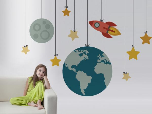 Cohete, tierra, luna y estrellas