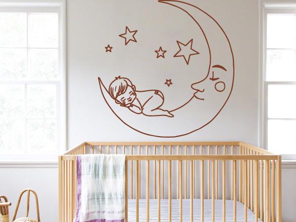 Niño durmiendo en la luna