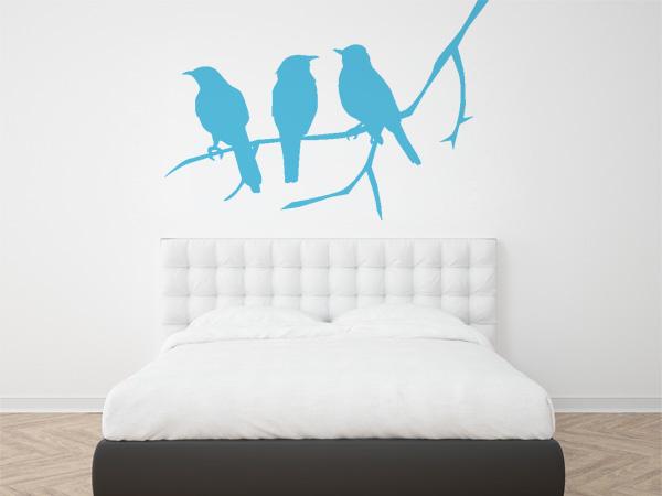 Tres pájaros rama