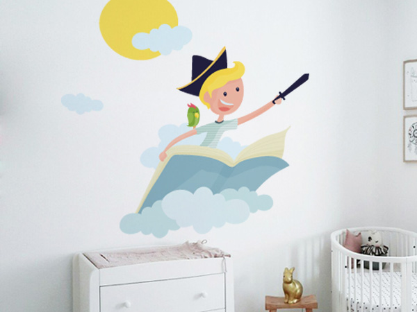 Niño volando sobre un libro